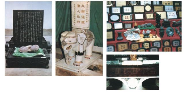 """滿工金鑲寶鑽、玉雕、白象係由緬甸白玉製成,白象全身所嵌翡翠、藍寶石、黃金寶、紫羅鑽石、紅寶石、南非鑽、墨晶鑽、瑪瑙等共計二千五百九十四顆。寶石及鑽石均採自天然,共計價值一千五百餘萬人民幣。此為本會代表全球五大洲全體會員,藉""""義雲高大師(H.H.第三世多杰羌佛)館""""落成大典之日,為表華僑四海同心,對大師德懺恭敬敬仰之意,奉作賀禮。"""